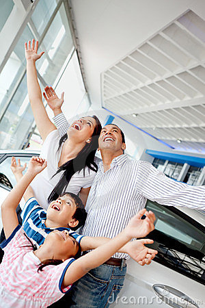 Family celebrating buying a car