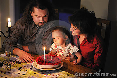Family celebrating daughter s second birthday