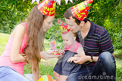 Family celebrating first birthday of their beloved daughter