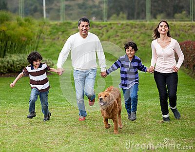 Family chasing a dog