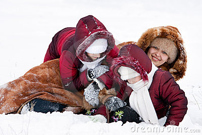Family cheerfully play to snow