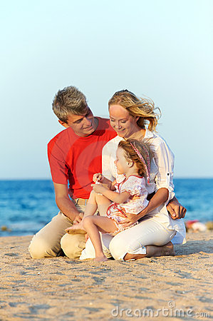 Family with child at sea beach