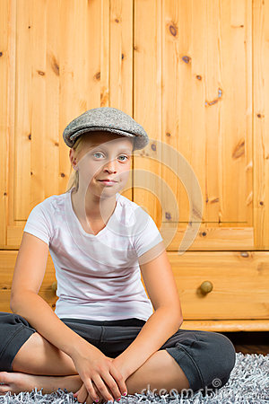 Family - child sitting with cap in room