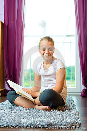 Family - child or teenager reading a book