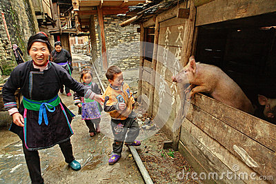 Family with children of Chinese farmers, stands near the pigsty. Editorial Photo