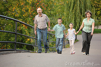 Family with children is handies on bridge