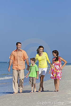 Family With Children Walking Having Fun At Beach