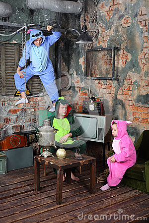 Family in colorful carnival costumes in very old room