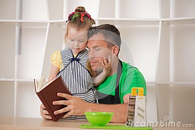 Family concept, cute little girl with father