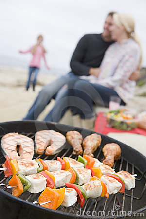 Free Family Cooking Barbeque On A Beach Royalty Free Stock Image - 7230686