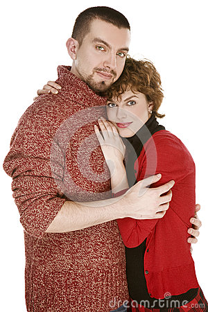 Family couple man and woman in red dress hugging