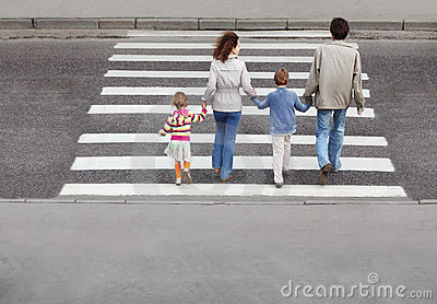 Family and crossing road, behind