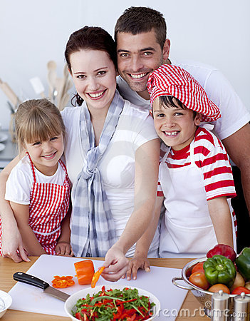 Free Family Cutting Colourful Vegetables In Kitchen Stock Images - 11450924