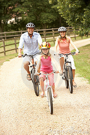 Family Cycling In Countryside Wearing Safety Helme Royalty Free Stock Photos - Image: 15555638