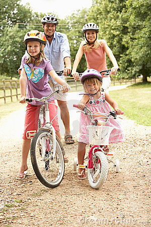 Free Family Cycling In Countryside Wearing Safety Helme Royalty Free Stock Photo - 15555535