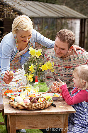 Free Family Decorating Easter Eggs On Table Outdoors Royalty Free Stock Image - 15936056
