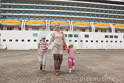 Family in dock, cruise ship on background