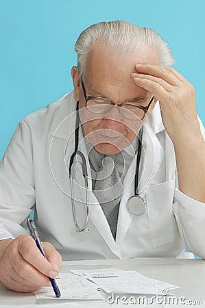 Family doctor prescribing medication