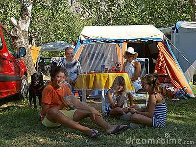 Family with dog at a camp