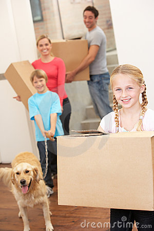 Family with dog on moving daycarrying cardboard bo