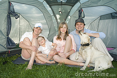 Family with dog in tent