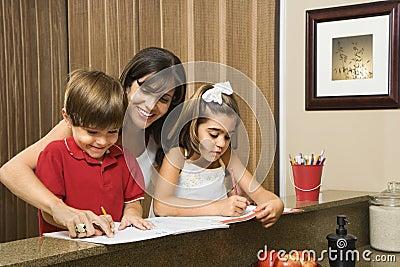 Family doing homework.