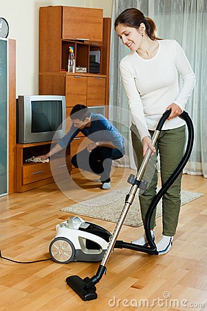 Family   doing housework together in home