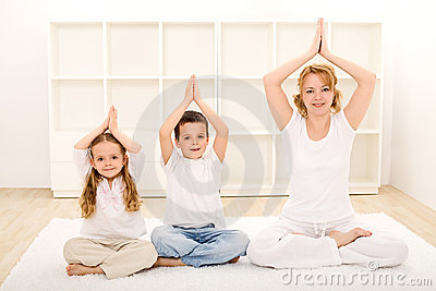 Family doing yoga exercises