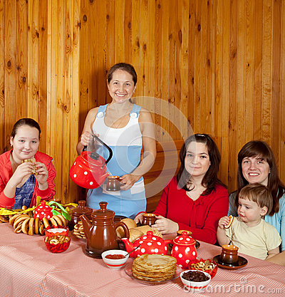 Family  drinking tea with russian  snack
