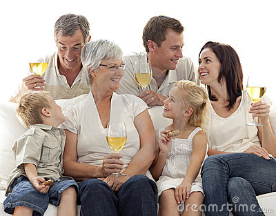 Family drinking wine and children eating biscuits