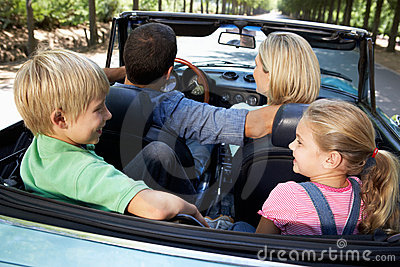 Family driving in sports car