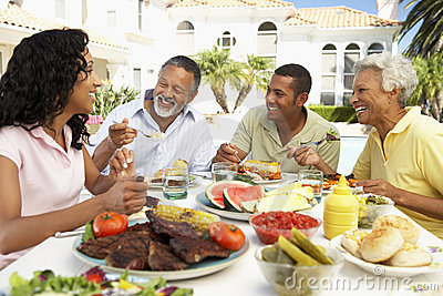 Family Eating An Al Fresco Meal