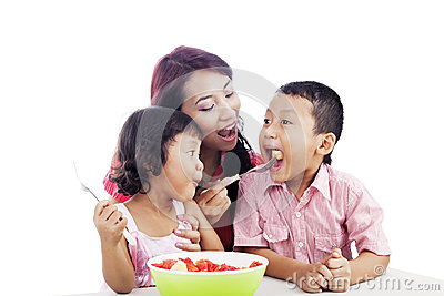 Family eating Fruit Salad