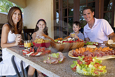 Family Eating Healthy Salad and Food Meal