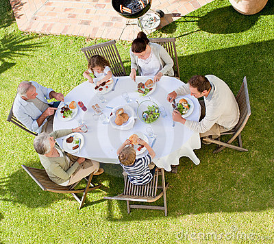 Free Family Eating In The Garden Stock Photo - 18441490