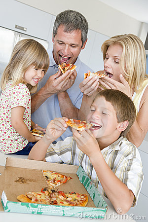 Free Family Eating Pizza Together Royalty Free Stock Photos - 6880278