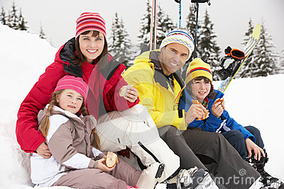 Family Eating Sandwich On Ski Holiday In Mountains