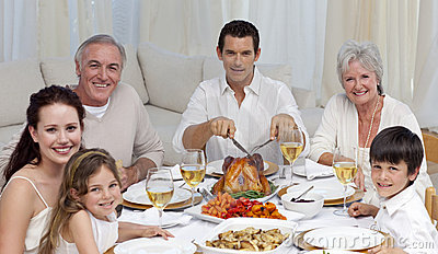 Family eating turkey in a celebration meal
