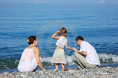 Family on edge of sea