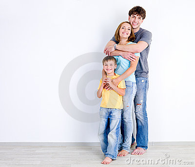 Family in embrace near the wall