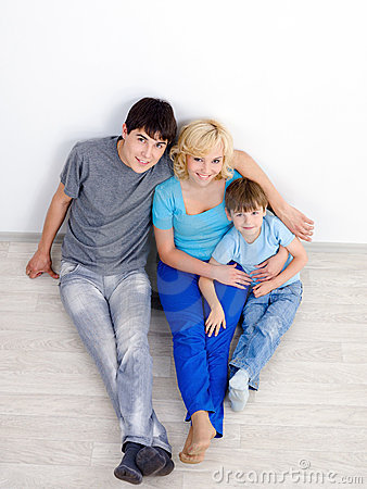 Family in the empty room - high angle