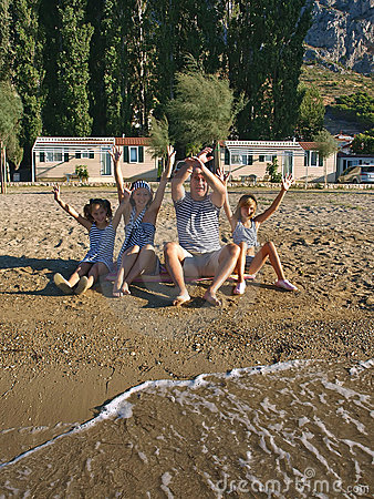 Family enjoy on sand beach