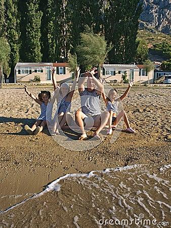 Family enjoy on sand beach