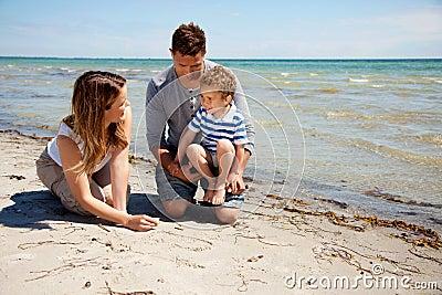 Family Enjoying Bonding Time on the Beach