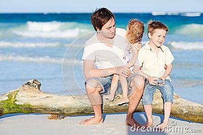 Family enjoying evening by the sea