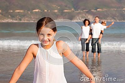 Family enjoying a stroll on the beach