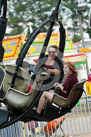 Family Enjoys Carnival Ride At County Fair Editorial Photo
