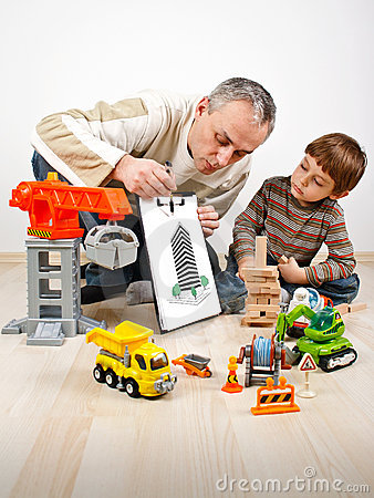 Family father boy build toys