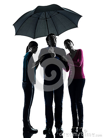 Family father mother daughter under umbrella