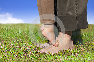 Family feet on the grass